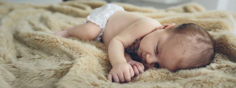 Baby sleeping on a blanket stock photo