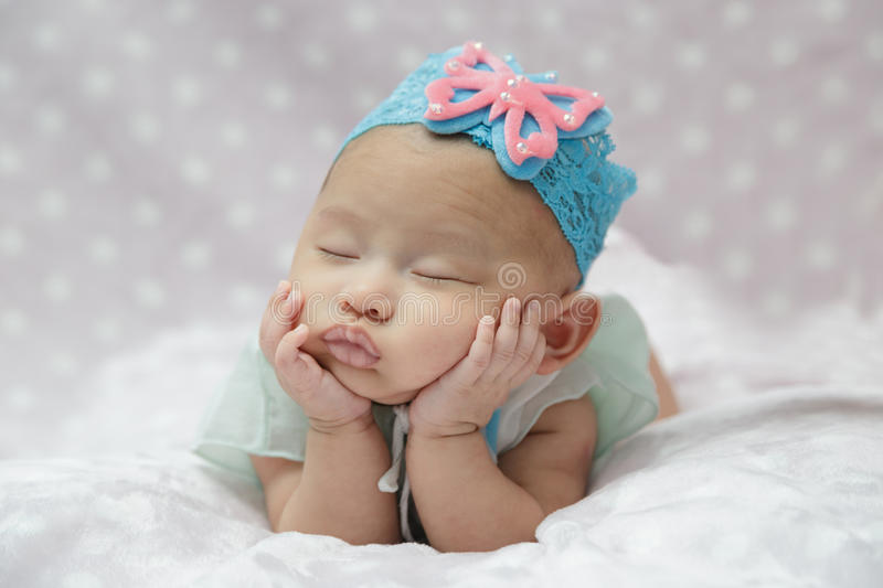 Baby sleeping. Newborn baby girl sleeping. asian stock photo