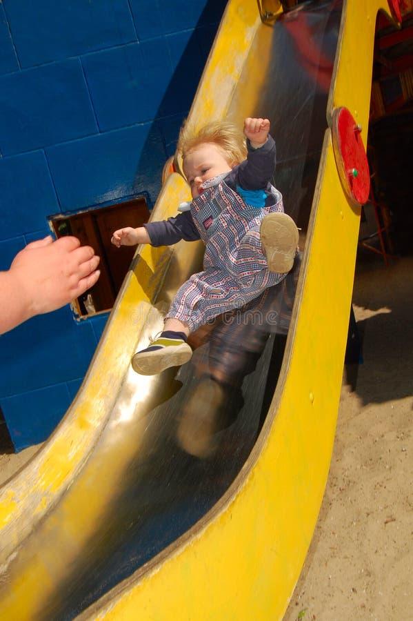 Baby sliding down royalty free stock photos