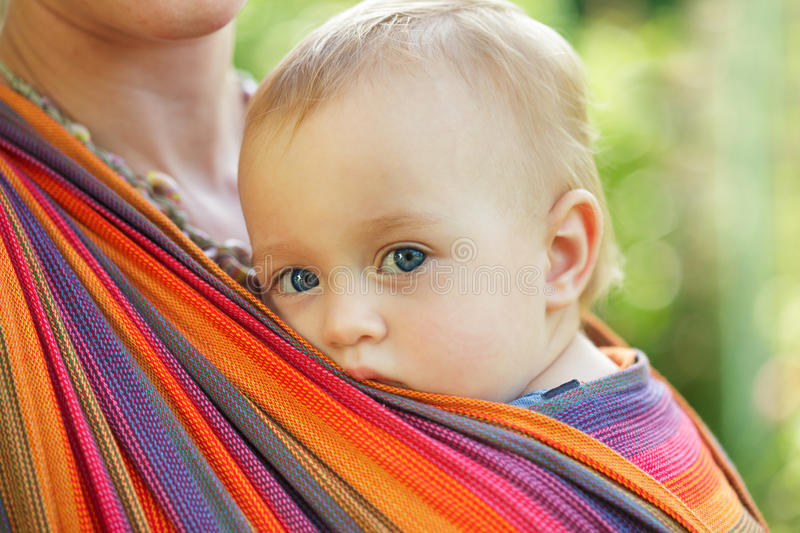 Baby in sling royalty free stock photography