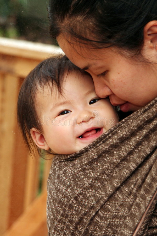 Download Baby in Sling stock photo. Image of wear, smile, sling - 4604462