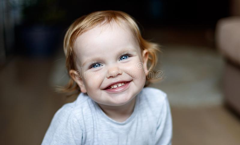 Baby smiling close-up. Happy two year old girl. royalty free stock photo
