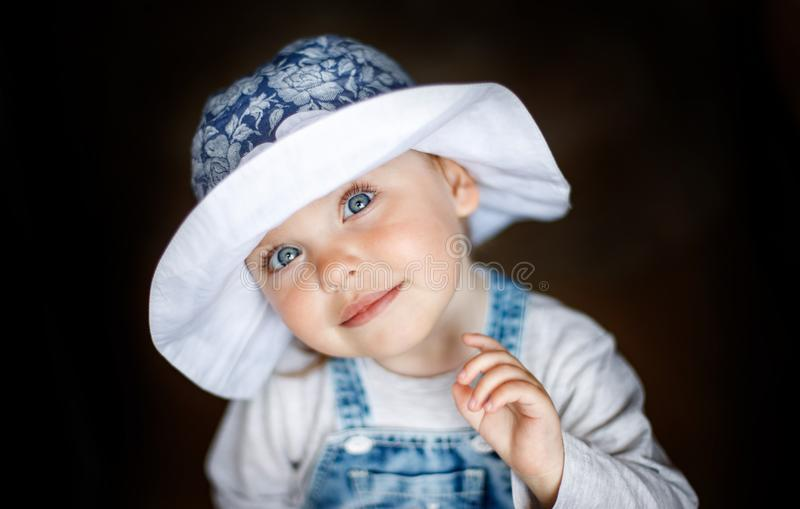 Little child baby smiling. Baby in a hat. Baby smiling close-up. Happy two year old girl. stock image