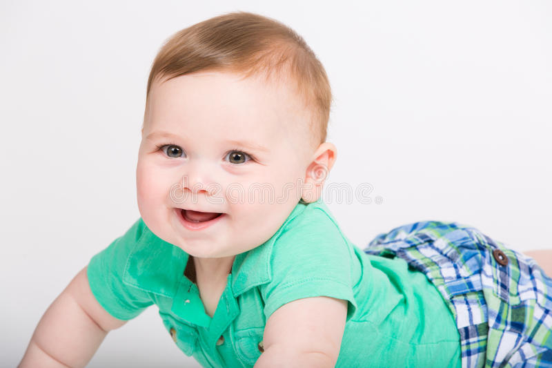 Baby Smiling on Stomach Close Up stock image