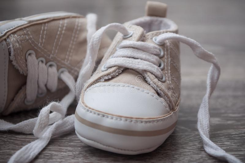Baby sneakers on the floor stock image