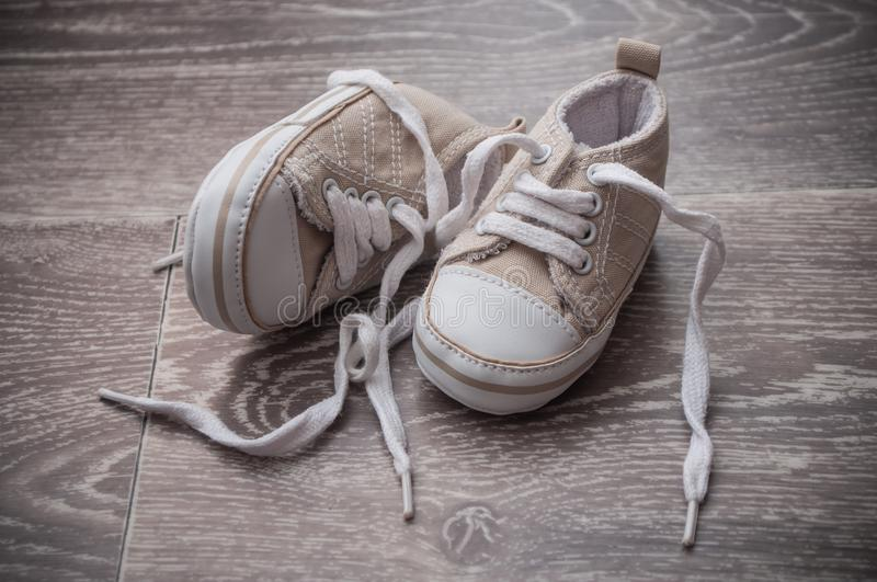 Baby sneakers on the floor royalty free stock photo
