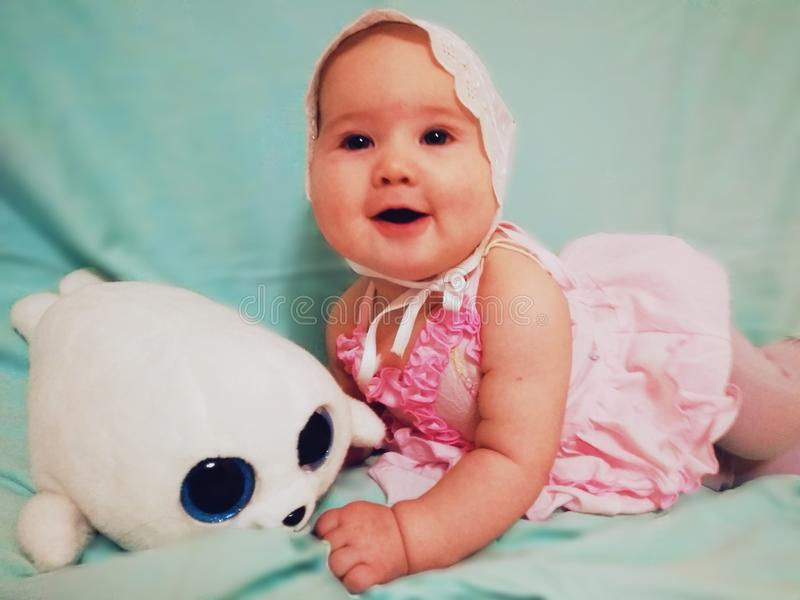 Beautiful small baby with soft a toy stock photography