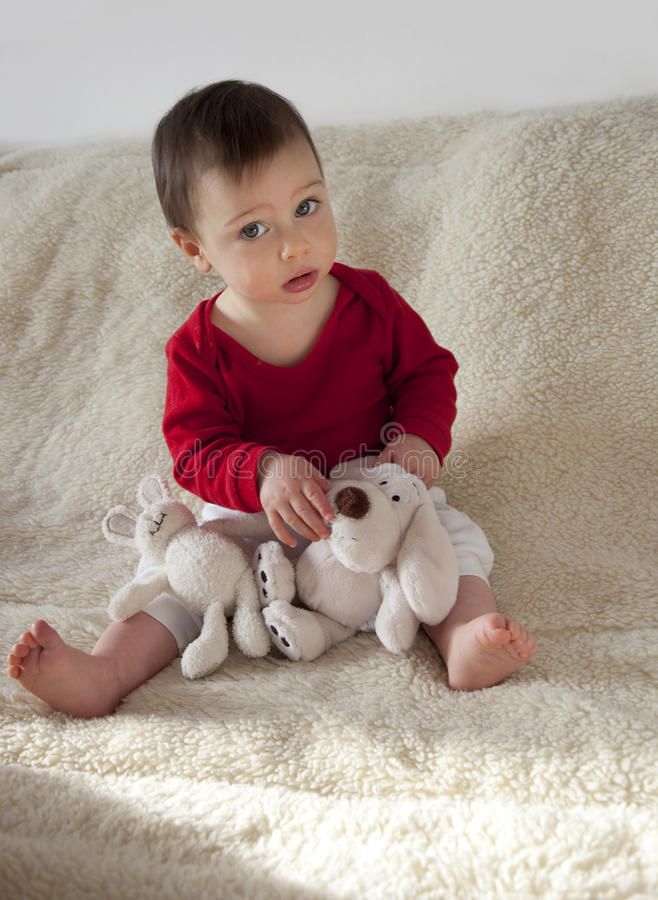 Download Baby with soft toys stock photo. Image of little, look - 12231714
