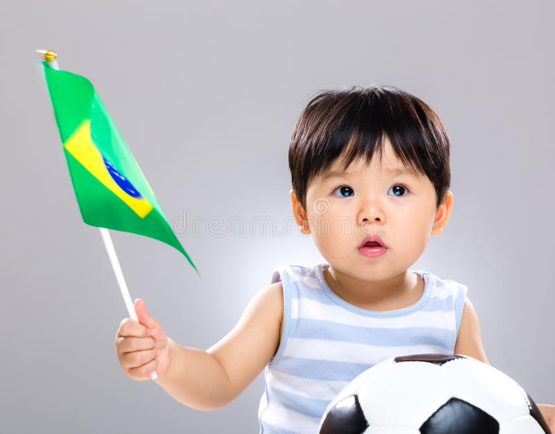 Download Baby Son Holding Flag Amd Soccer Ball Stock Image - Image: 40944351