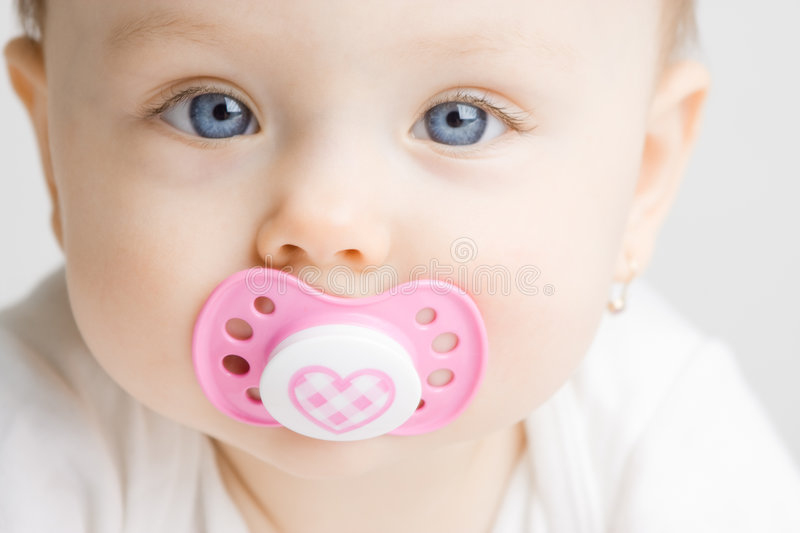 Baby with soother royalty free stock photo