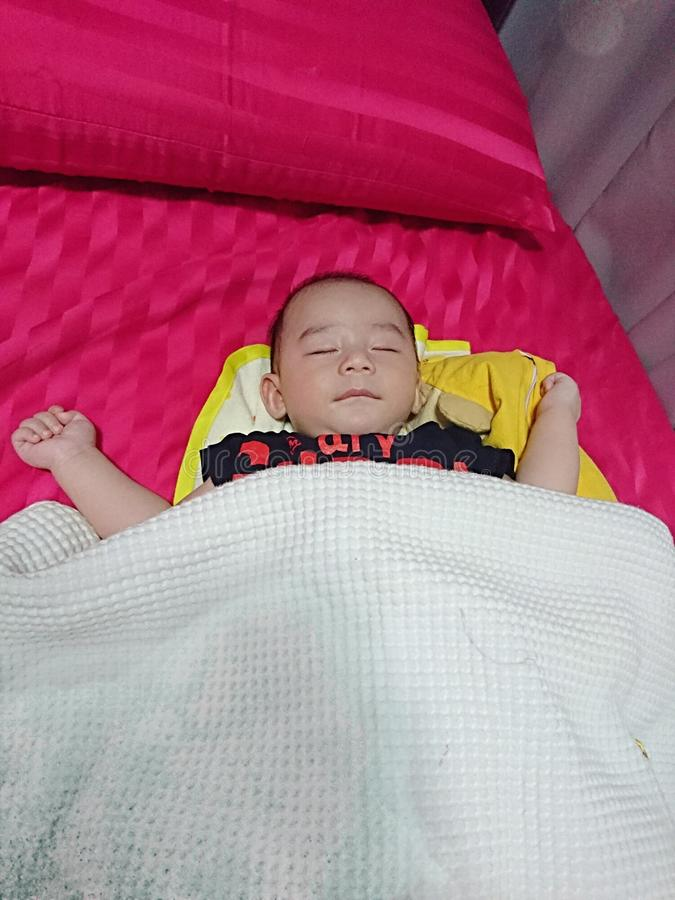 Baby soundly asleep royalty free stock photo