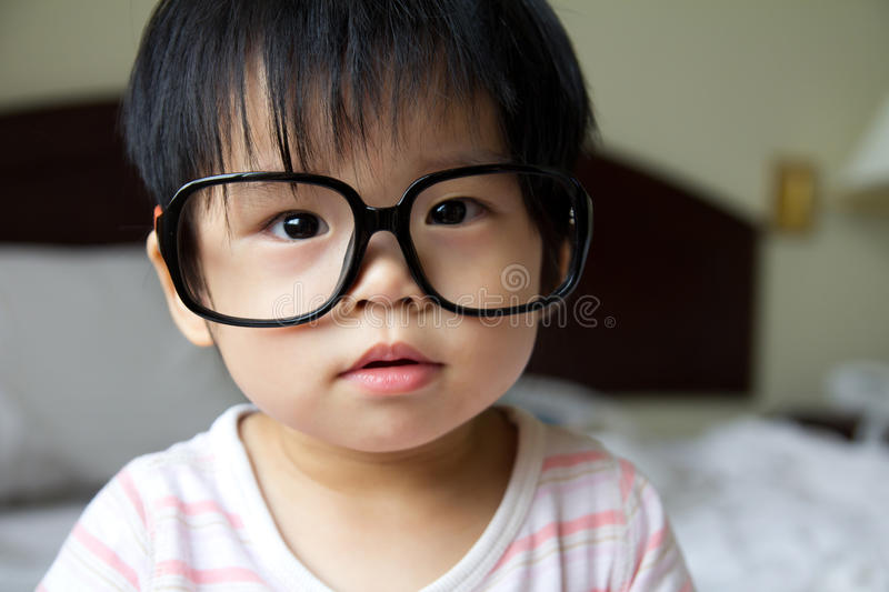 Baby in spectacles stock photo