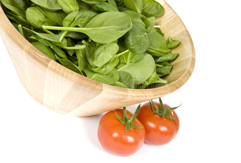 Baby Spinach And Vine Ripen Tomatoes Royalty Free Stock Photos