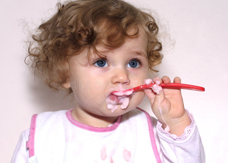 Baby with a spoon royalty free stock image