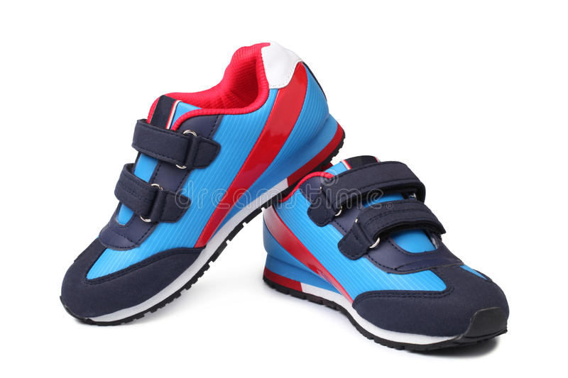 Baby sport shoes pair. On white background royalty free stock photography