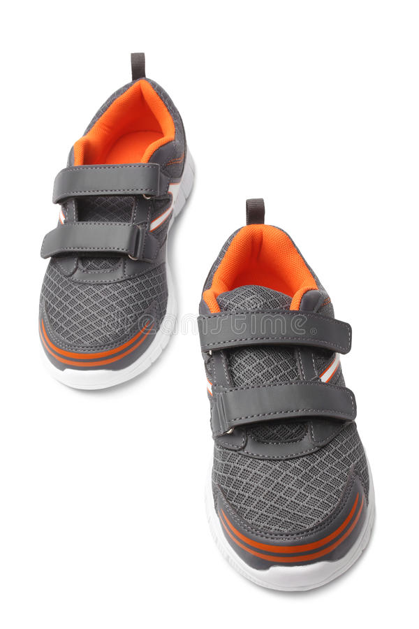 Baby sport shoes pair. On white background stock photos