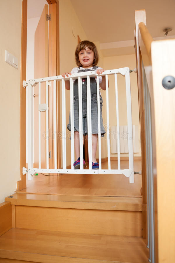 baby and the stair gate stock photography image 36489842. Black Bedroom Furniture Sets. Home Design Ideas