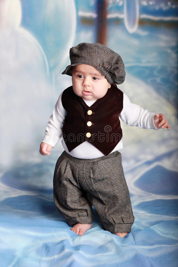 Baby standing. Five month old boy standing on his own stock photo