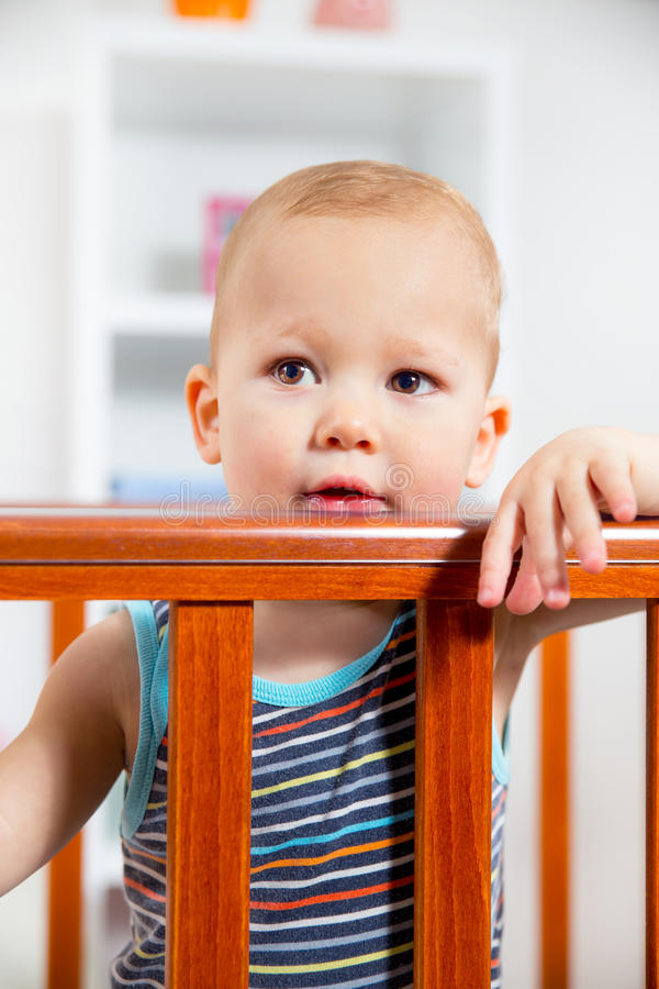 Baby Standing In The Crib. Baby Boy Standing In The Crib royalty free stock photography