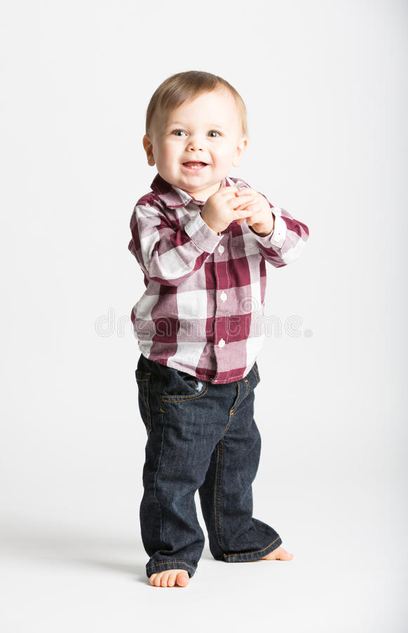 Free Baby Stands In Flannel And Jeans Holding Hands Royalty Free Stock Photos - 61713678