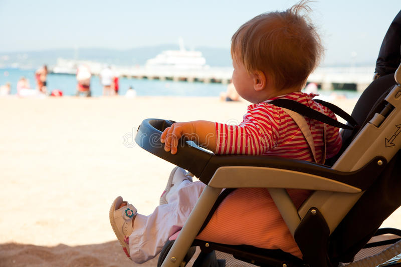 Download Baby In The Stroller  On  Beach Resort Stock Image - Image: 25069565