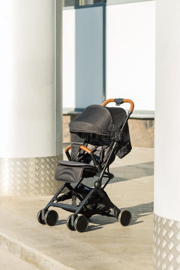 Baby stroller standing on the street, new design. royalty free stock image