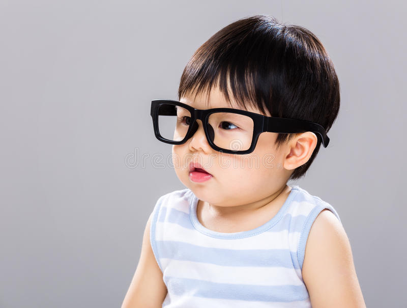 Baby student. With gray background royalty free stock images