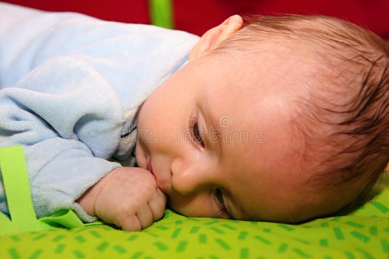 Baby sucks the thumb royalty free stock photos
