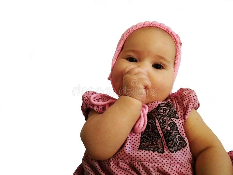 The baby sucks a thumb. Isolated royalty free stock photo