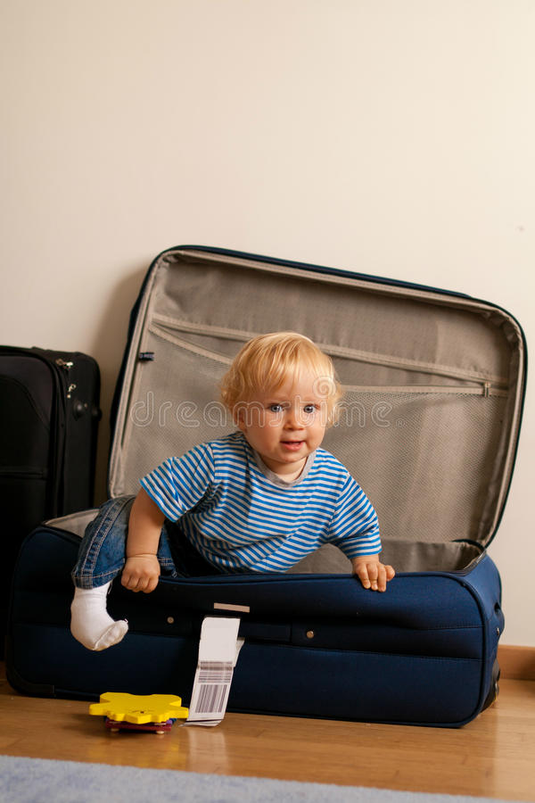 Baby in suitcase stock photos