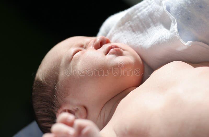 Baby in the sun stock photo