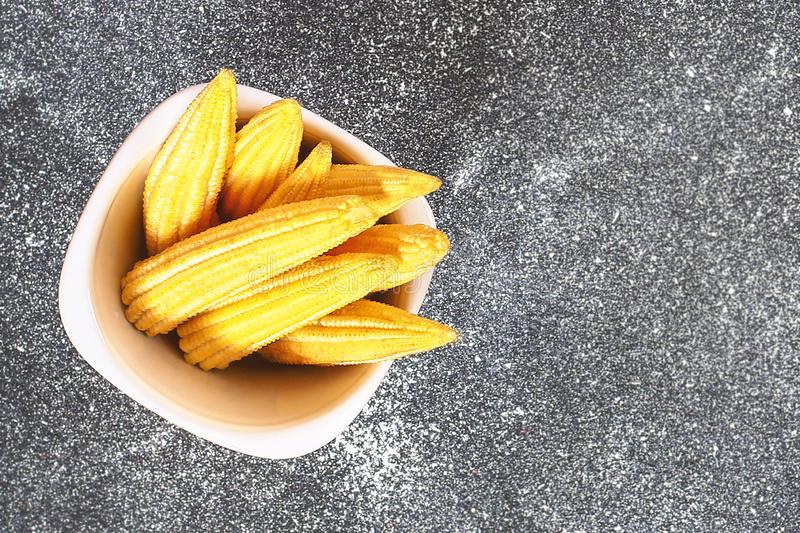 Baby sweetcorn or mini corn. It is typically the eaten whole cob included for the human consumption. It is eaten both raw and cook. Ed. Baby corn is common in royalty free stock images