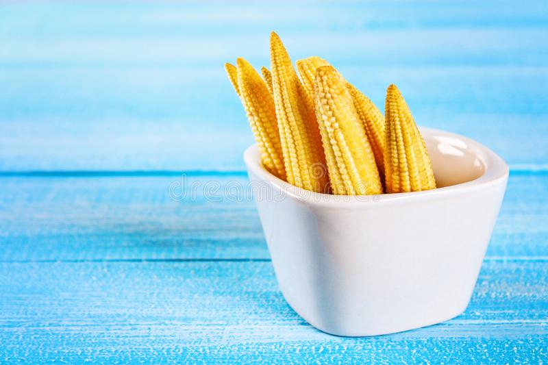 Baby sweetcorn or mini corn. It is typically the eaten whole cob included for the human consumption. It is eaten both raw and cook. Ed. Baby corn is common in stock photos