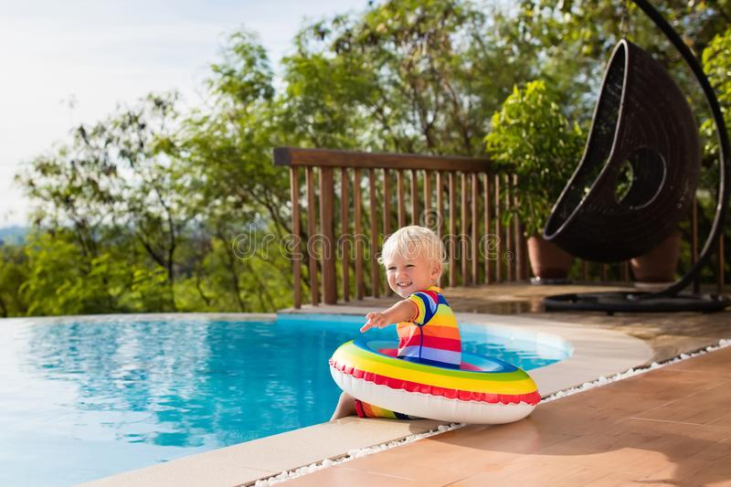 Baby in swimming pool. Kids swim. Child summer fun. Baby in swimming pool. Little boy playing in outdoor pool. Kids learn to swim. Child with inflatable toy stock photography