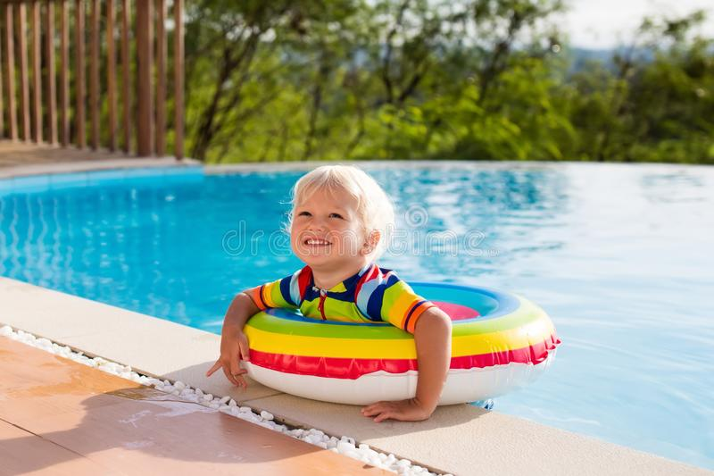 Baby in swimming pool. Kids swim. Child summer fun. Baby in swimming pool. Little boy playing in outdoor pool. Kids learn to swim. Child with inflatable toy stock photo