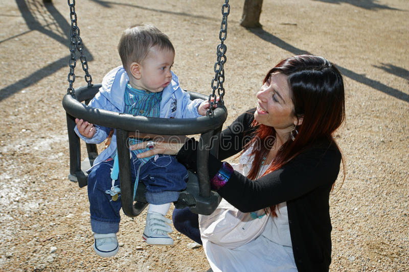 Download Baby on a swing stock photo. Image of park, mommy, outdoor - 14455842