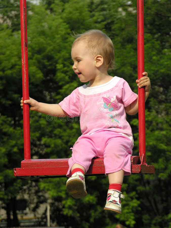 Baby on swing royalty free stock image