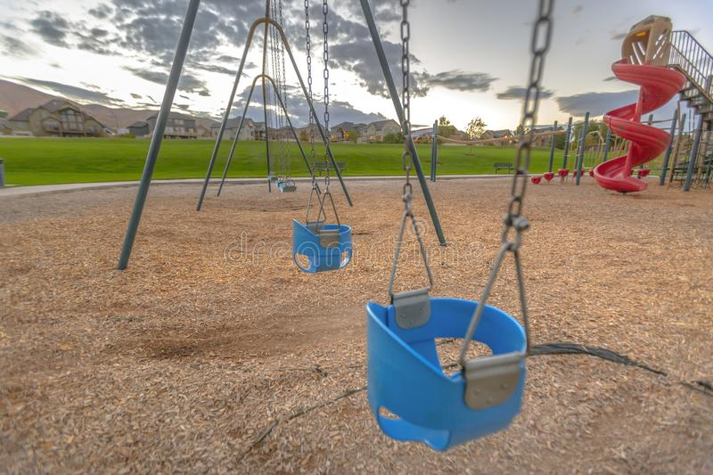 Baby swing and spiral slide in Saratoga Springs UT stock photo