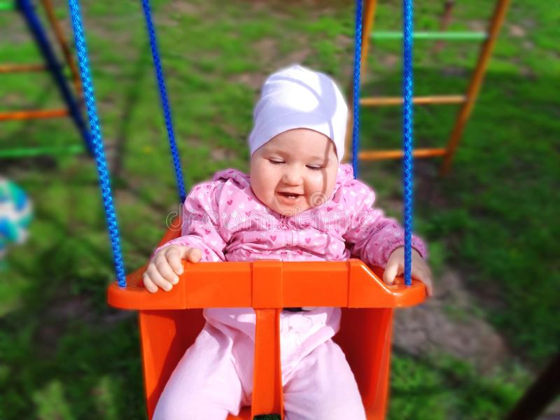 Baby swinging on the swing royalty free stock photos