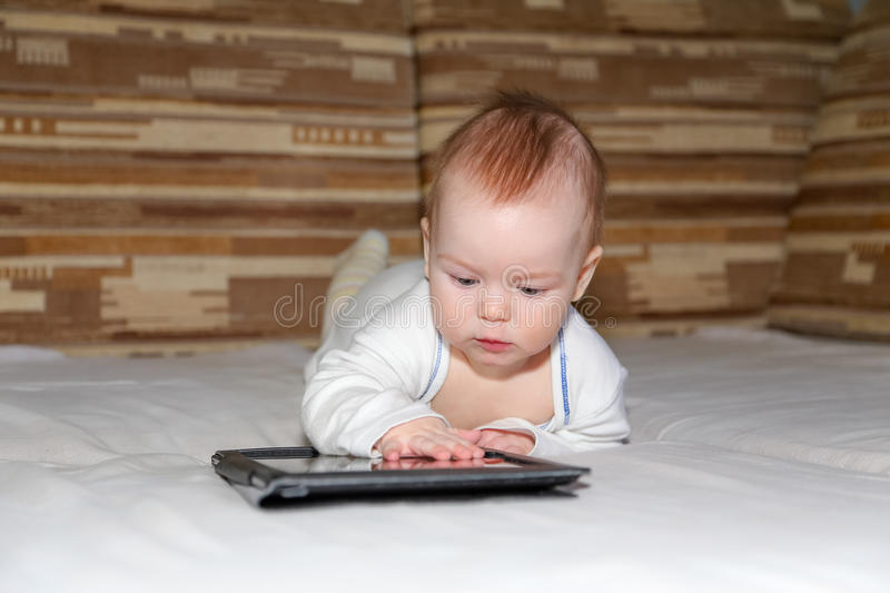 Baby and tablet computer. Baby exploring new tablet computer royalty free stock image
