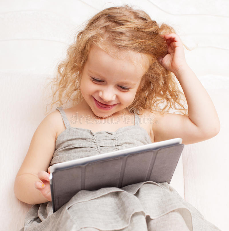 Baby with tablet computer stock image
