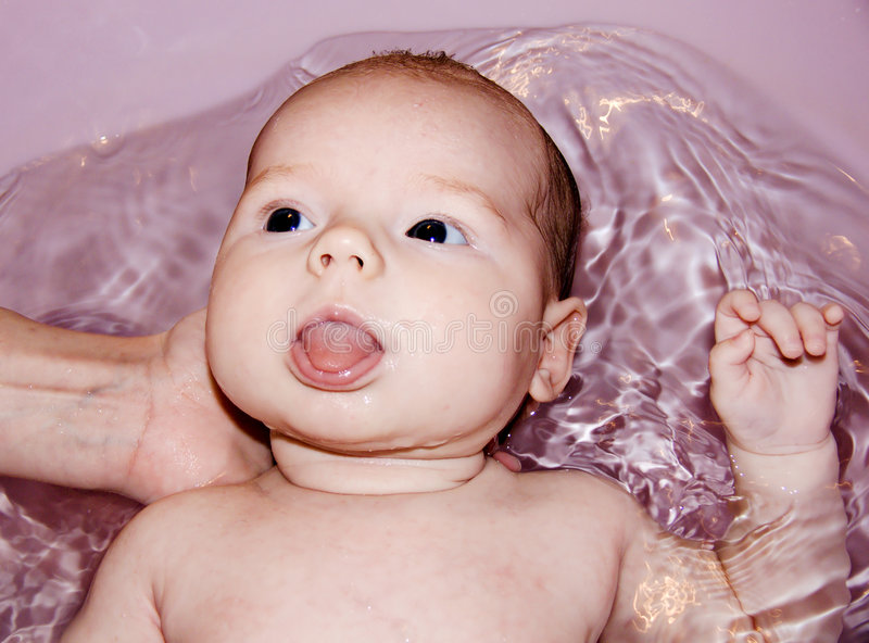 Baby is taking a bath stock photography