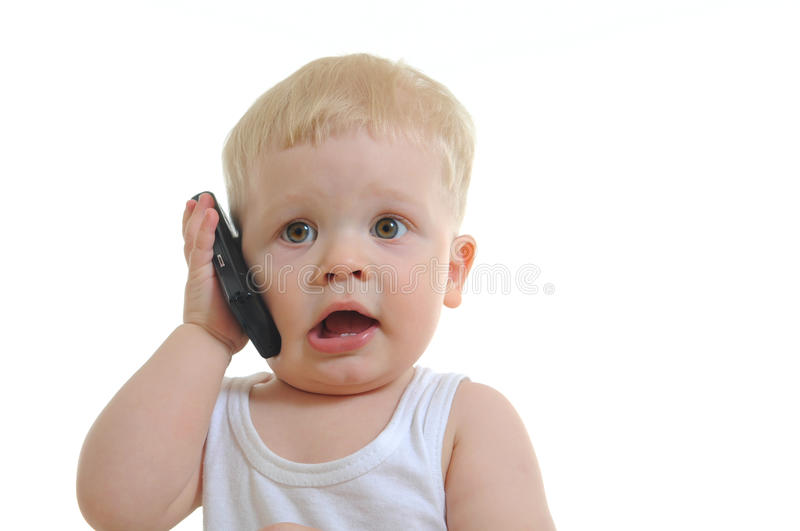 Baby talking on mobile phone stock photography