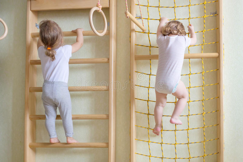 Baby toddlers climbing up the stairs. royalty free stock images