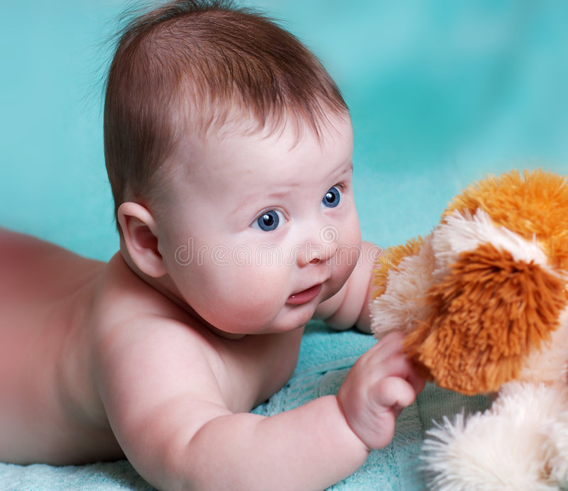 Baby with the toy royalty free stock photo