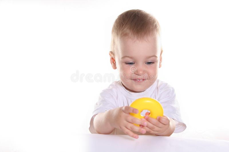 Baby with toy ring stock photo