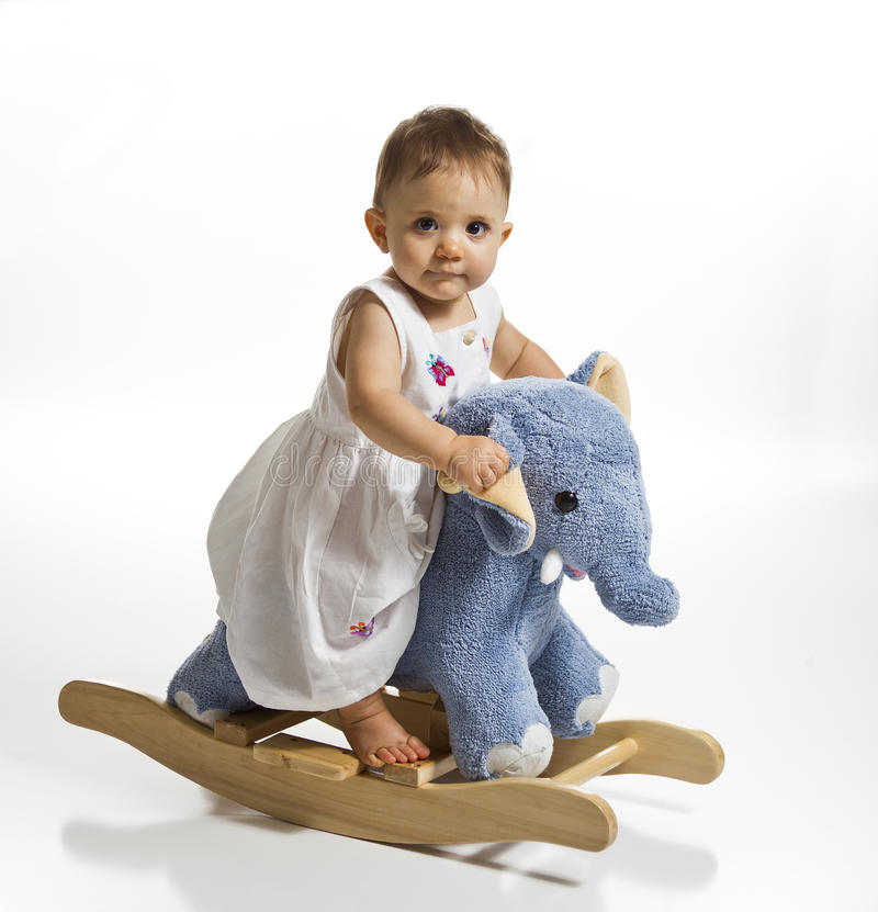 Baby on toy rocking horse stock images