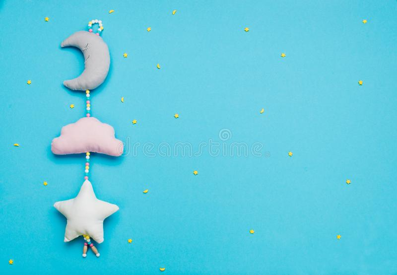 Baby toys moon, cloud and star on blue background with copyspace royalty free stock photography
