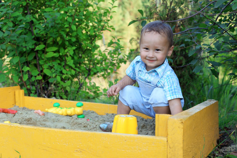 Download Baby with toys in sandbox stock image. Image of joyful - 21292843