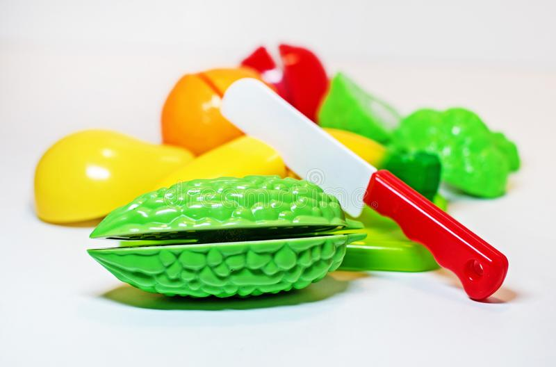 Baby toys vegetables and fruits on white background stock photos